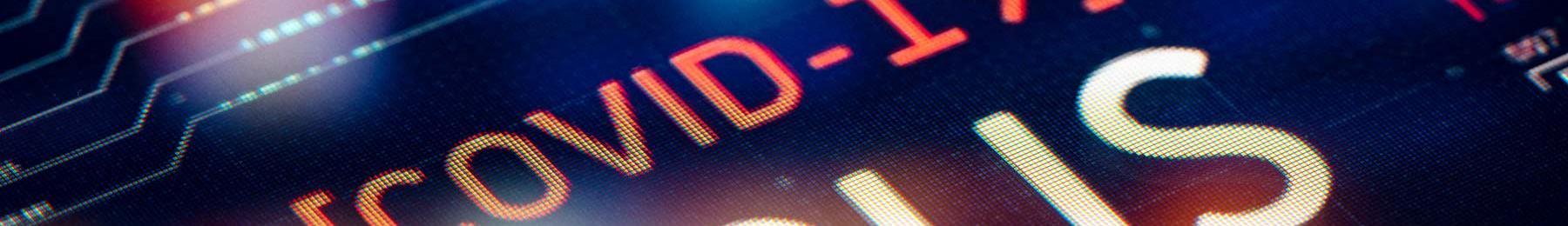 digital screen displaying COVID-19